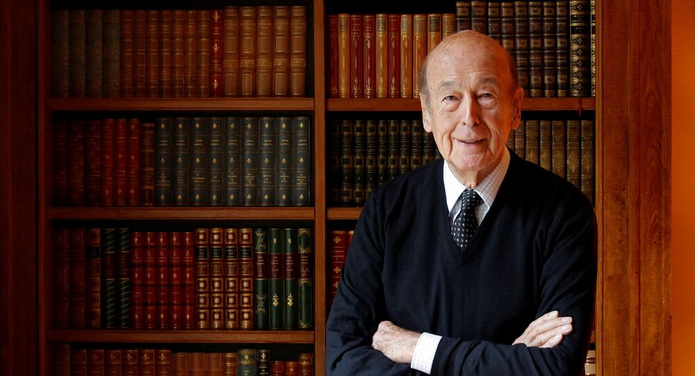 Former French President Valery Giscard d'Estaing poses in his office at his Paris home during an interview with Reuters, France, December 6, 2011