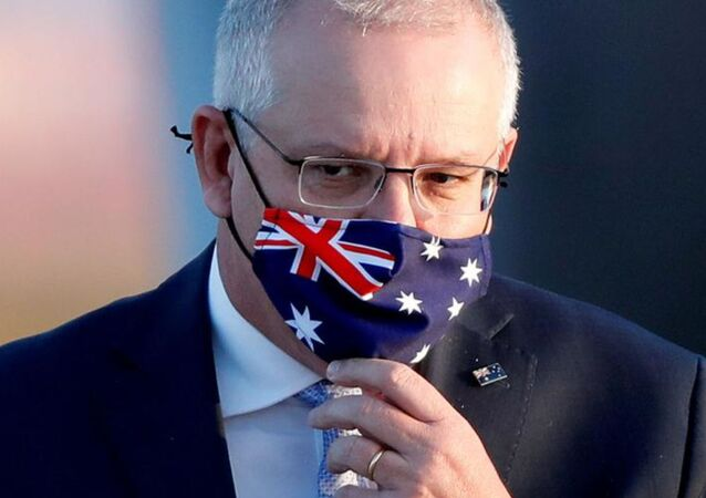 Australian Prime Minister Scott Morrison arrives at Haneda airport in Tokyo, Japan, November 17, 2020.