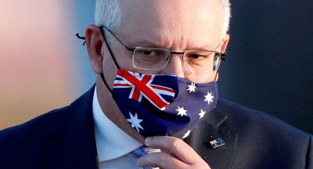 Australian Prime Minister Scott Morrison arrives at Haneda airport in Tokyo, Japan, November 17, 2020.