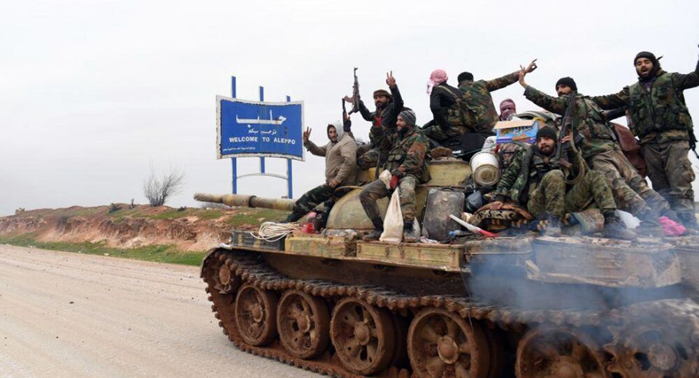 In this photo released Wednesday, Feb. 12, 2020, by the Syrian official news agency SANA, Syrian government soldiers on a tank hold up their rifles and flash victory signs, as they patrol the highway that links the capital Damascus with the northern city of Aleppo, Syria. The M5 highway, recaptured by President Bashar Assad's forces this week, is arguably the most coveted prize in Syria's civil war. The strategic highway is vital for Syria's  economy as well as for moving troops.