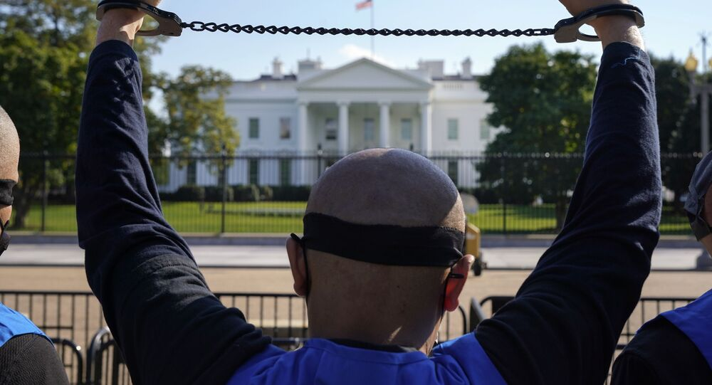 A member of the Uyghur American Association rallies in front of the White House, Thursday, Oct. 1, 2020, after marching from Capitol Hill in Washington, in support of the Uyghur Forced Labor Prevention Act which has passed the House and now will go on to the Senate.