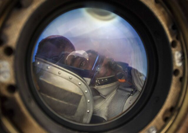 In this handout photo released by Gagarin Cosmonaut Training Centre (GCTC), Roscosmos space agency, NASA astronaut Chris Cassidy sits in the capsule shortly after the landing near town of Dzhezkazgan, Kazakhstan, Thursday, Oct. 22, 2020.
