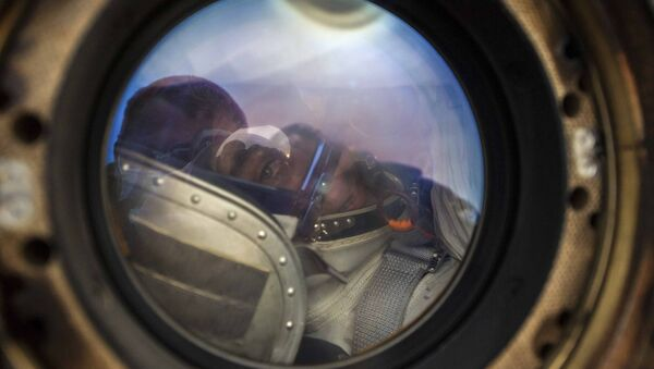 In this handout photo released by Gagarin Cosmonaut Training Centre (GCTC), Roscosmos space agency, NASA astronaut Chris Cassidy sits in the capsule shortly after the landing near town of Dzhezkazgan, Kazakhstan, Thursday, Oct. 22, 2020.  - Sputnik International