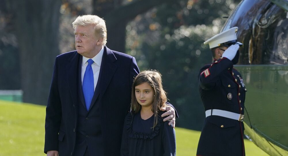 President Donald Trump walks with his granddaughter Arabella Kushner on the South Lawn of the White House in Washington, Sunday, Nov. 29, 2020