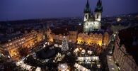 This combination image shows a file photo dated Thursday, 5 December 2019 of the traditional Christmas Market at the Old Town Square in Prague, Czech Republic, top, and the square on Saturday, 28 November 2020, below.