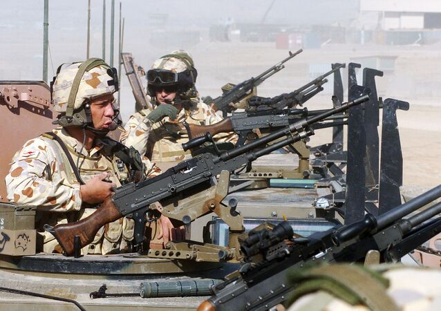 (FILES) Australian soldiers of the NATO-led International Security Assistance Force (ISAF) keep guard on top of armored vehicles, in Tirin Kot, the capital of Uruzgan province, on February 17, 2007