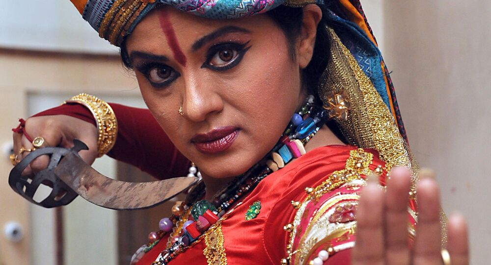 Indian bollywood actress Sudha Chandran poses during an event celebrating the 150th anniversary of Kabiguru Rabindranath Tagore in Mumbai on June 22, 2010