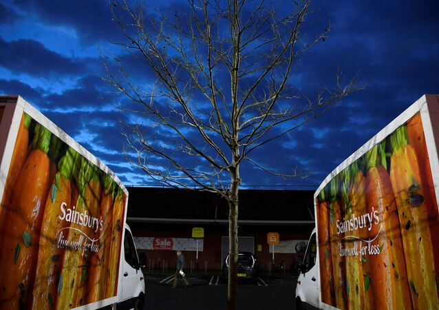 Signage for Sainsbury's is seen on delivery vans at a branch of the supermarket in London, Britain, January 8, 2020