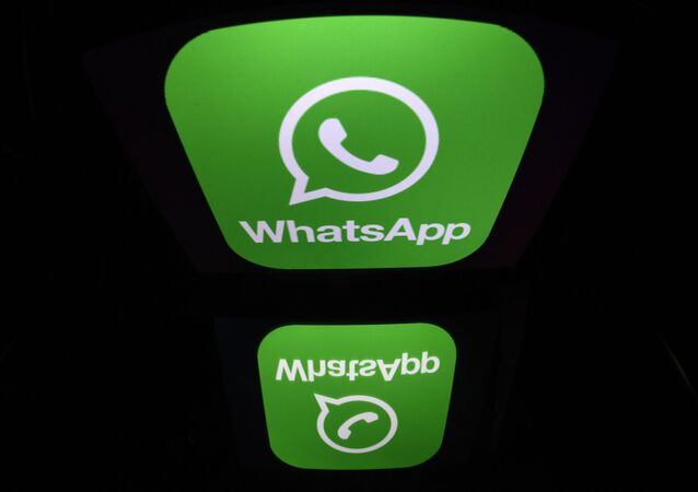 A picture taken on December 28, 2016 in Paris shows the logo of WhatsApp mobile messaging service