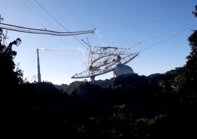 Screenshot shows the exact moment in which the cables attached to the Arecibo Observatory's radio telescope snap and send the structure crashing down to the dish platform.
