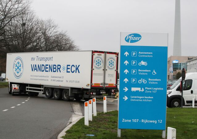 A refrigerated truck leaves the Pfizer factory in Puurs, Belgium December 3, 2020.