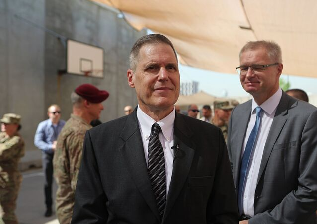 Matthew Tueller, center, the U.S. ambassador to Iraq, attends a transfer authority ceremony at Union III, base in Baghdad, Iraq, Saturday, Sept. 14, 2019. U.S. Army Lt. Gen. Pat White, III Armored Corps Commanding General, assumed command of the Combined Joint Task Force-Operation Inherent Resolve from U.S. Army Lt. Gen. Paul LaCamera