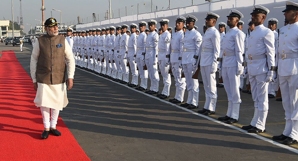 In this photograph released by the Indian Navy on December 14, 2017, Prime Minister Narendra Modi inspects a guard of honour during an event to commission the INS Kalvari Scorpene-class submarine into the Indian Navy at the naval dockyard in Mumbai