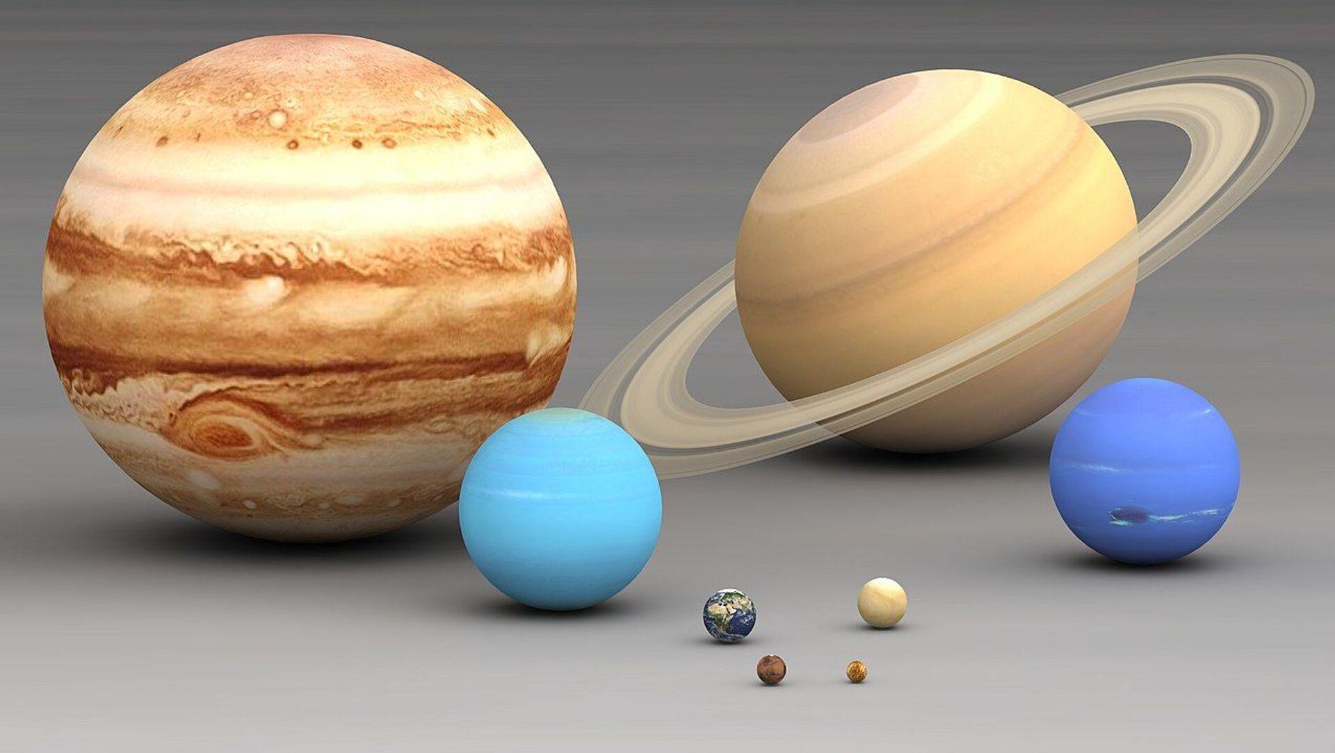 Solar system planets size comparison. Largest to smallest are pictured left to right, top to bottom: Jupiter, Saturn, Uranus, Neptune, Earth, Venus, Mars, Mercury - Sputnik International, 1920, 29.07.2021