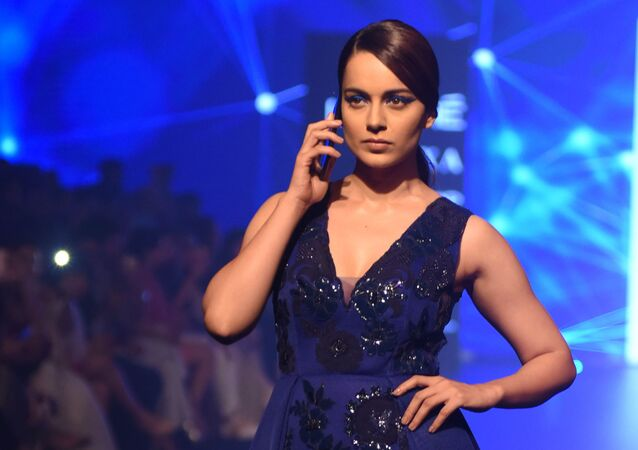 Indian Bollywood actress Kangana Ranaut showcases a creation by designer Pankaj & Nidhi at the Lakmй Fashion Week (LFW) Winter/Festive 2018 in Mumbai late on August 25, 2018