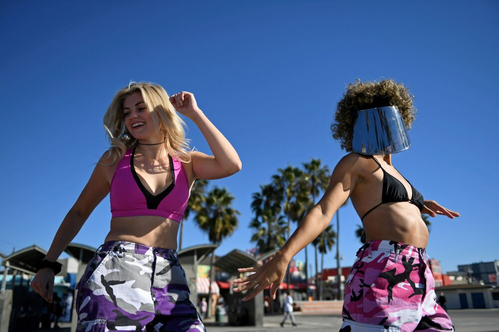People rollerblade along the beach a day before renewed restrictions due to a surge of coronavirus disease (COVID-19) cases in Los Angeles, California, 29 November 2020.