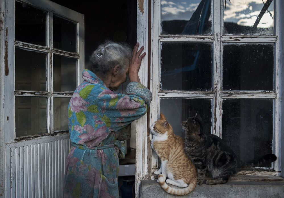 An elderly woman near her home in the town of Lachin (Berdzor) in Nagorno-Karabakh. In line with the trilateral ceasefire agreement in Nagorno-Karabakh, the Lachin region has been transferred to Azerbaijan.
