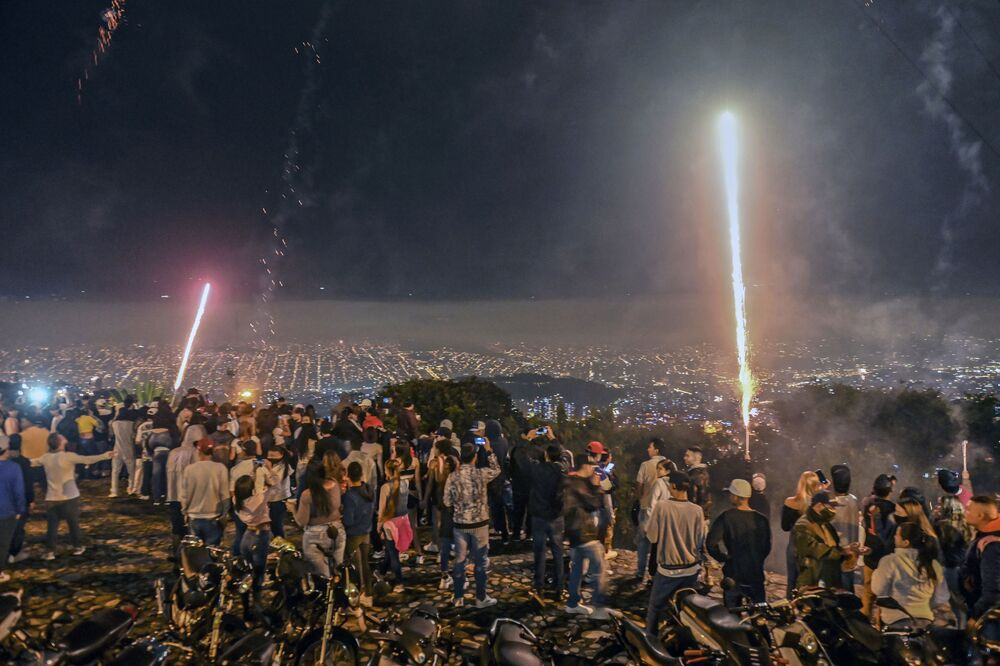 People watch fireworks during Alborada, a tradition to celebrate the arrival of the Christmas season, in Medellin, Colombia, on 1 December 2020 amid the COVID-19 novel coronavirus pandemic.