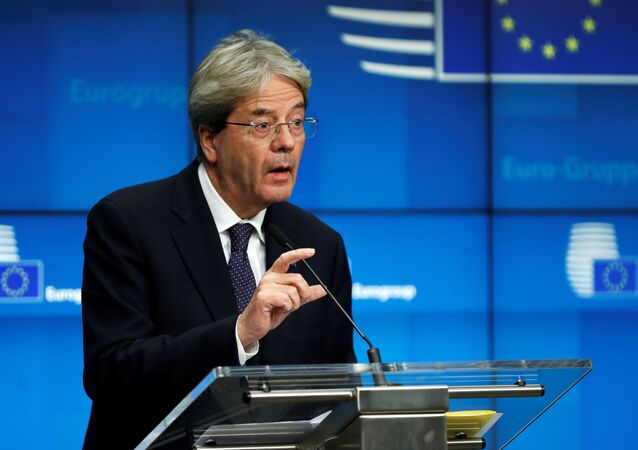 European Commissioner for Economy Paolo Gentiloni speaks during an online news conference following a Eurogroup video conference meeting at the European Council headquarters in Brussels, Belgium November 30, 2020.