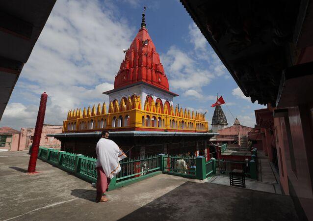 A sadhu stands outside Hanuman Garhi Mandir in Ayodhya, in the Indian state of Uttar Pradesh, Thursday, Aug. 6, 2020
