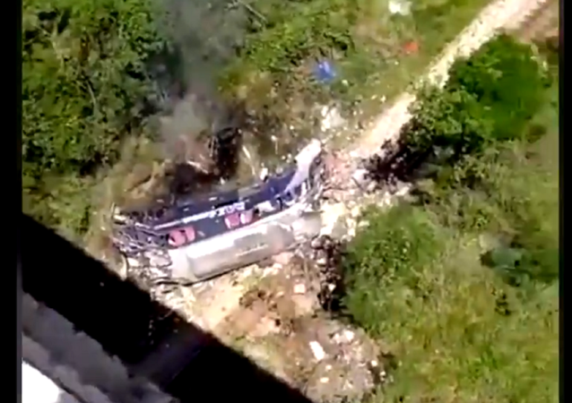 A screenshot from the video showing the crashed bus lying on the ground beneath the bridge. December 4, 2020