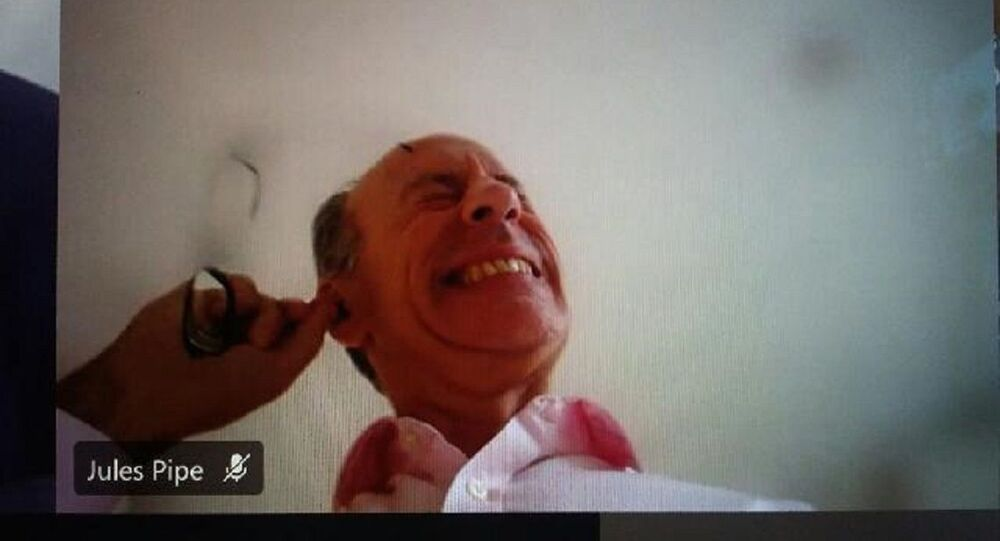 A screenshot from the video conference showing London's Deputy Mayor Jules Pipe CBE scratching his ear to get the wax out, December 3, 2020