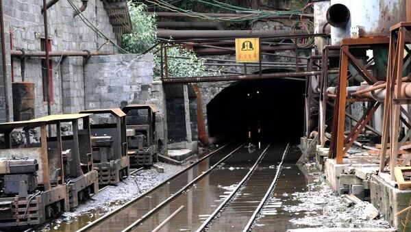 This recent but undated photo shows a gallery exit of the damaged Lajiapo coal mine in China's southern region of Guangxi. Underground water flooded the Lajiapo and Longshan mines around on July 17, 2001 - Sputnik International