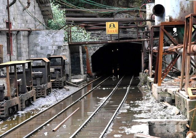 This recent but undated photo shows a gallery exit of the damaged Lajiapo coal mine in China's southern region of Guangxi. Underground water flooded the Lajiapo and Longshan mines around on July 17, 2001