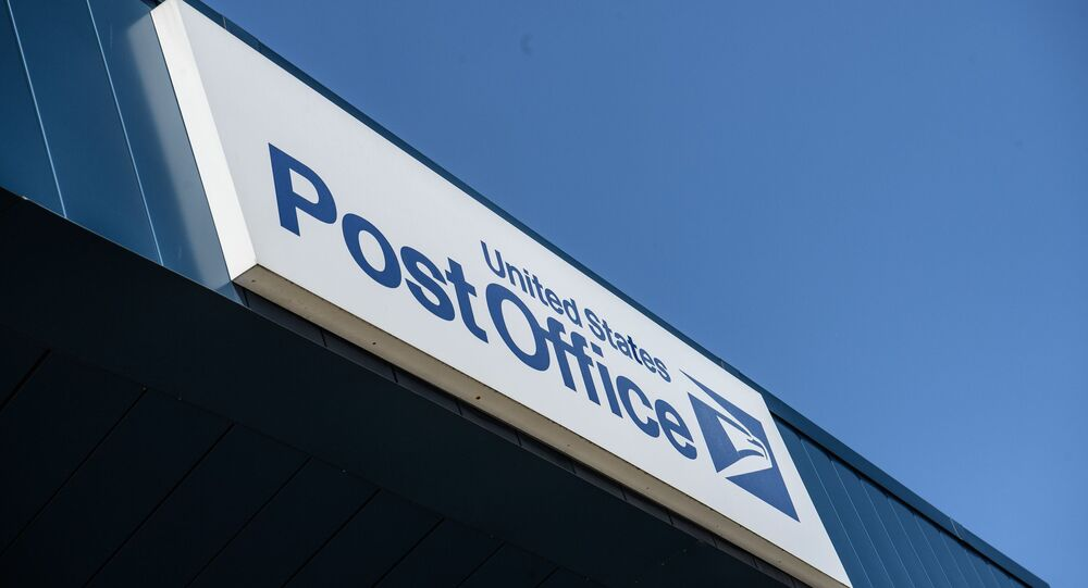 A sign is seen on a United States Postal Service (USPS) post office in Washington, DC, on August 18, 2020. - The US Postal Service said on August 18 it will halt changes blamed for slowing mail delivery until after the November election, changing course in the wake of the political firestorm President Donald Trump ignited when he acknowledged he wanted to undermine the agency.