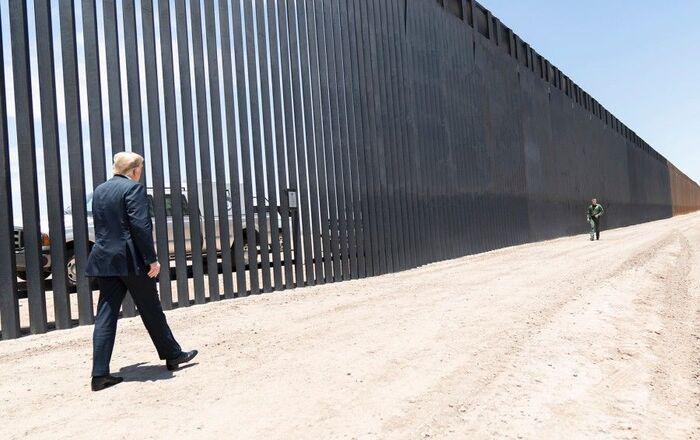 President Donald Trump walks along the completed 200th mile of new border wall on June 23, 2020, along the U.S.-Mexico border near Yuma, Arizona.