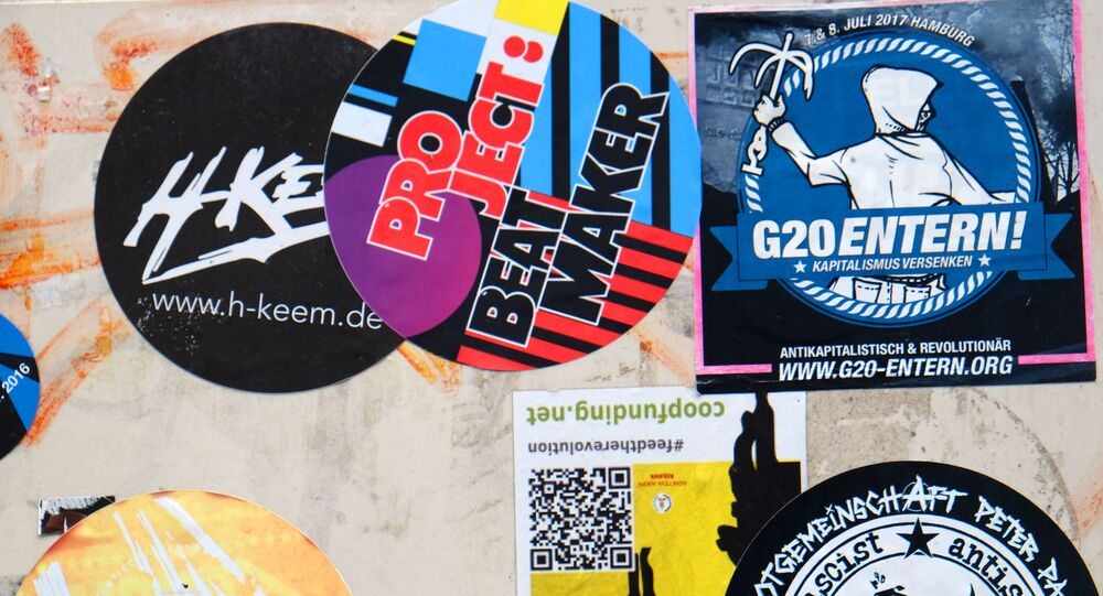 Stickers which adress the G20 summit are pictured on walls and lightpoles in Hamburg, northern Germany on 20 July 2017.