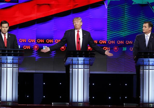 Republican presidential candidate, businessman Donald Trump, center, speaks as candidates, Sen. Marco Rubio, R-Fla., left, and Sen. Ted Cruz, R-Texas, right, listen, during the Republican presidential debate sponsored by CNN, Salem Media Group and the Washington Times at the University of Miami,  Thursday, March 10, 2016, in Coral Gables, Fla.