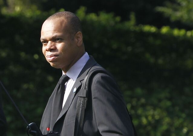 Director of the Office of Political Affairs Patrick Gaspard walks across the South Lawn of the White House in Washington as he accompanies President Barack Obama to Wisconsin and California, Monday, Aug. 16, 2010