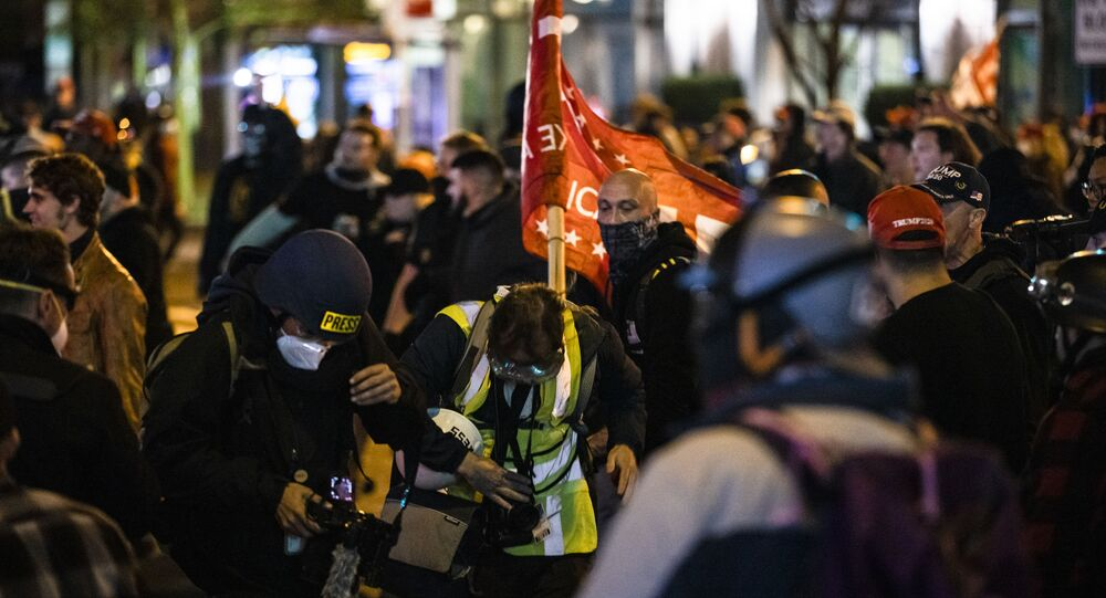 Members of Antifa and the Proud Boys clash in the middle of the street following the Million MAGA March on 14 November in Washington, DC.