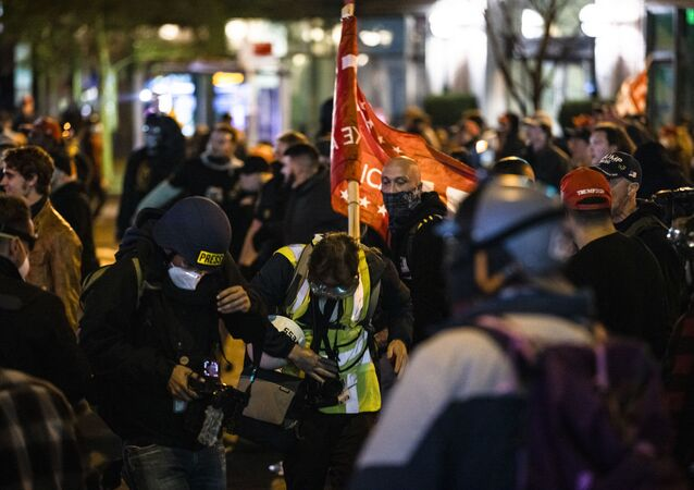 Members of Antifa and Proud Boys clash in the middle of the street after the Million MAGA March on 14 November 2020 in Washington, DC.