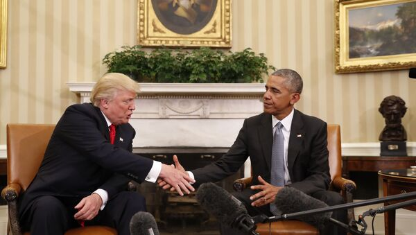 In this Nov. 10, 2016 file photo, President Barack Obama shakes hands with then-President-elect Donald Trump in the Oval Office of the White House in Washington - Sputnik International