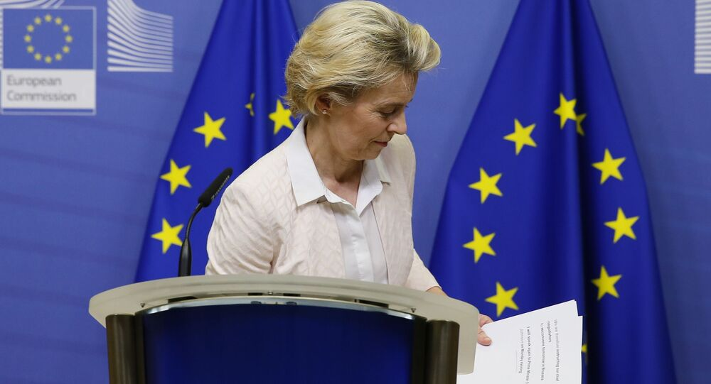 European Commission President Ursula von der Leyen leaves after giving a statement at the European Commission in Brussels, on December 5, 2020.