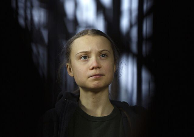 Swedish climate activist Greta Thunberg speaks with the media as she arrives for a meeting of the Environment Council at the European Council building in Brussels, Thursday, March 5, 2020