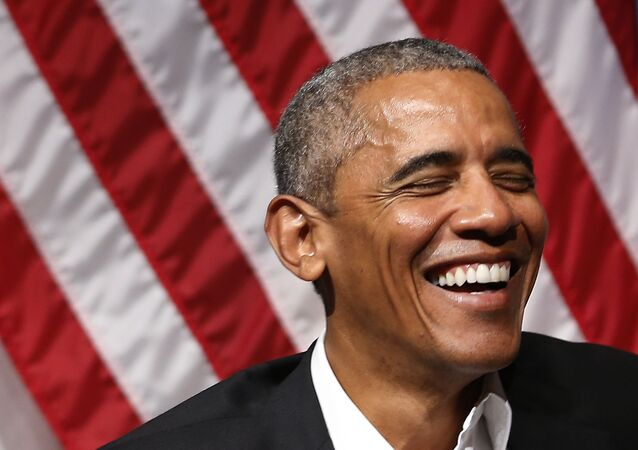 Former US President Barack Obama laughs during a forum with young leaders to discuss community organizing an at the University of Chicago in Chicago, Illinois on April 24, 2017.