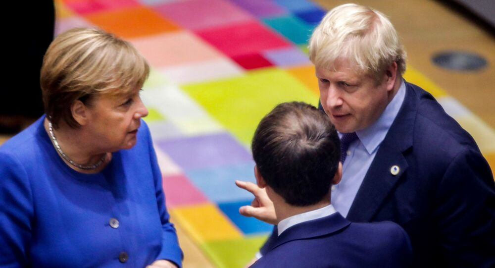British Prime Minister Boris Johnson (R), French President Emmanuel Macron (C) and German Chancellor Angela Merkel (L) speak upon their arrival for a round table meeting as part of a European Union summit at European Union Headquarters in Brussels on October 17, 2019.