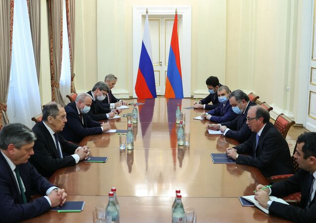 In this handout photo released by Russian Foreign Ministry, Russian Foreign Minister Sergei Lavrov attends a meeting with his Armenian counterpart Ara Aivazian, in Yerevan, Armenia