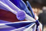 A Brexit pin is attached to a flag, in London, Friday, Jan. 31, 2020