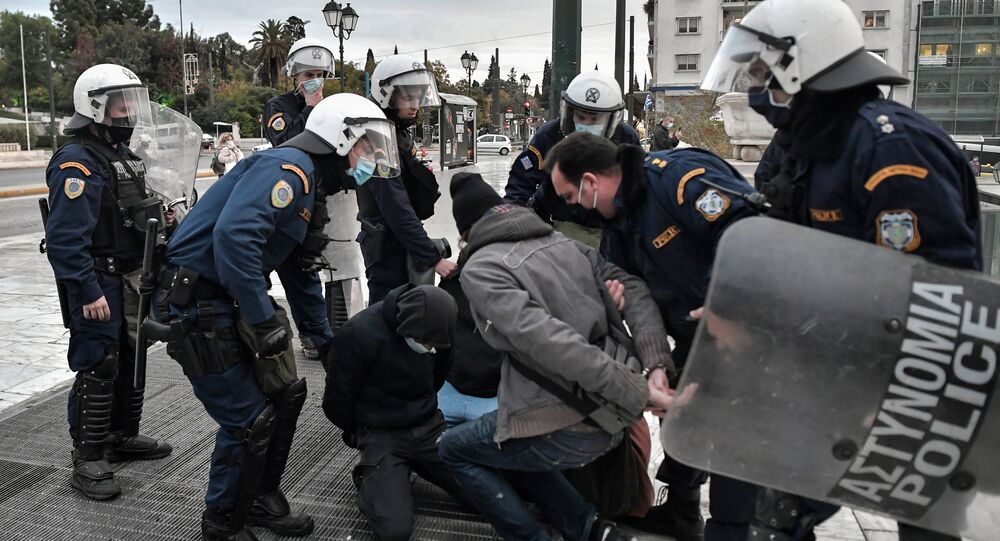 Police arrest demonstrators in Athens during an attempt to demonstrate in front of the Greek Parliament in Athens on December 4, 2020 to commemorate the killing of Alexis Grigoropoulos by the police, which sparked month of rioting across the country in 2008