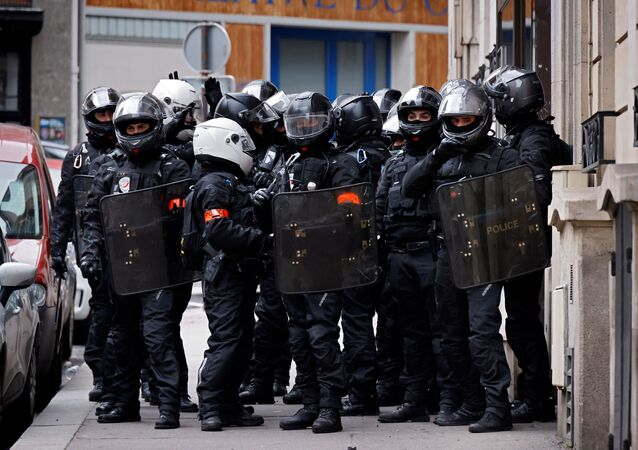 Picture taken on December 5, 2020 shows French police officers BRAV-M stand in the street during a demonstration for 'social rights' and against the 'global security' draft law, which Article 24 would criminalise the publication of images of on-duty police officers with the intent of harming their 'physical or psychological integrity', in Paris.