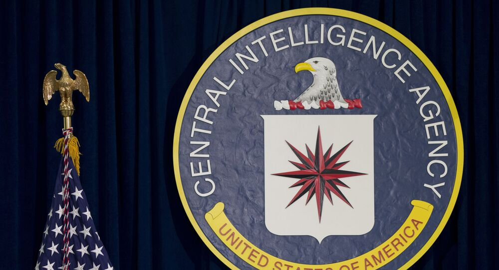 This April 13, 2016 file photo shows the seal of the Central Intelligence Agency at CIA headquarters in Langley, Va. James Pars, a CIA intelligence officer, says his career was derailed after he complained that his boss at a base in a conflict zone repeatedly ordered personnel to travel through dangerous areas on non-essential trips to shop and buy food