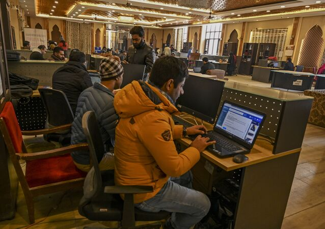 In this photo taken on December 3, 2019, Kashmiri students use the internet at a Tourist Reception Centre (TRC) in Srinagar, as internet facilities have been suspended across the region as part of a partial communication blockade by the Indian government