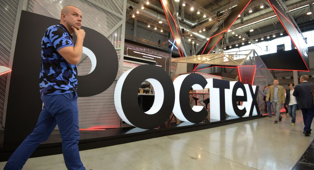 A visitor walks past Rostec's stand at the attends the Innoprom International Industrial Fair, in Yekaterinburg, Russia