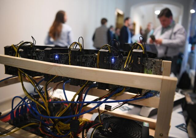 Bitcoin mining farm at the 3logic stand at the Russian Blockchain Week 2017 conference in Moscow