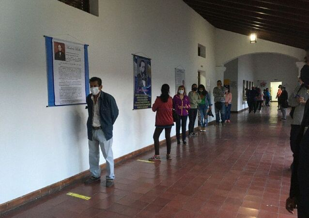People stand in line in Caracas to cast their vote in Venezuela's parliamentary election, 6 December 2020.