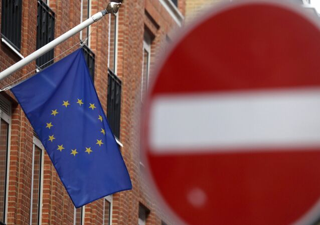 An EU flag flies on a building located in a one way street in London, Monday, Nov. 9, 2020